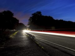 Car light trails on road at blue hour