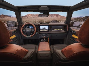 Prototype version, not representative of production model, of the all-new 2021 Bronco interior is highlighted by an available 12-inch SYNC® 4 system, optional leather trim seating, console-mounted transmission shifter/selector and G.O.A.T. Modes™ control knob. (Static display on private property with aftermarket accessories not available for sale.)