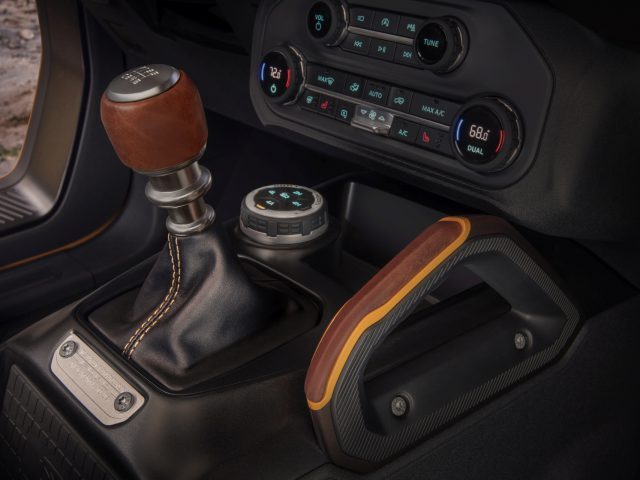 Customization details include an available leather-wrapped shift lever for the class-exclusive 7-speed manual transmission, as well as grab handles in this prototype version of the 2021 Bronco (not representative of production model). (Static display on private property with aftermarket accessories not available for sale.)