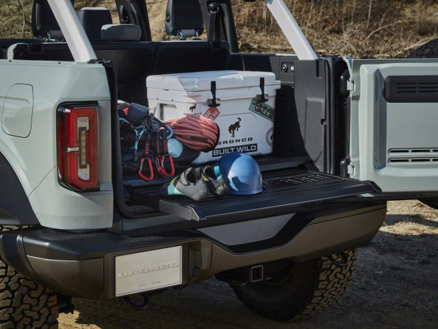 All 2021 Bronco two- and four-door models will offer a swingout rear tailgate for easier access to re rear cargo area as shown in this four-door Bronco prototype. (Prototype not representative of production vehicle.)