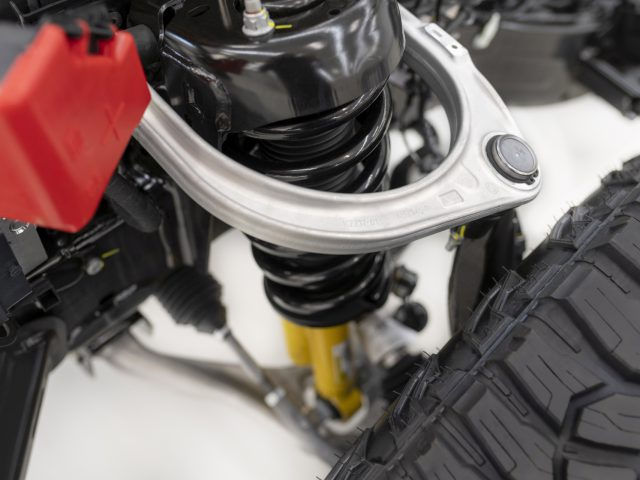 Forged aluminum alloy upper control arm helps reduce unsprung weight for smoother, more precise off-roading at speed.