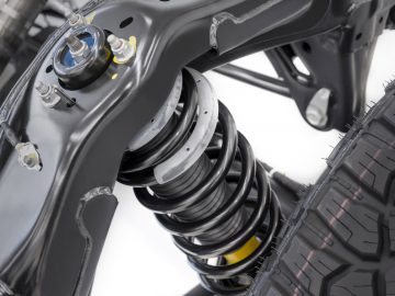 Rear coil-over spring/shock absorber mounted to the fully boxed high-strength steel Bronco frame.