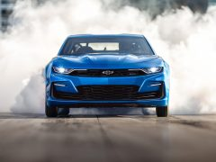 The eCOPO Camaro Concept offers an electrified vision of drag racing, with an electric motor and GM's first 800-volt battery pack replacing the gas engine, enabling 9-second quarter-mile times.